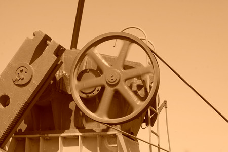 Beam pumping unit rotating wheels, closeup of photo