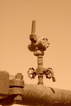 petroleum machinery pipe and handwheel, closeup of photo Editorial
