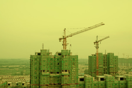 property development: Buildings and tower crane