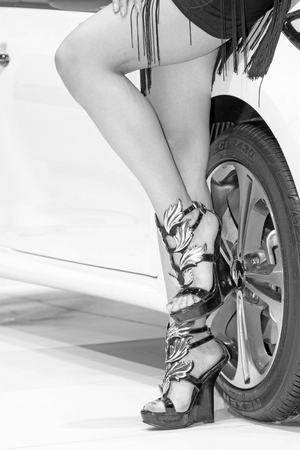 novel: wheels and novel high heels in a auto show Editorial