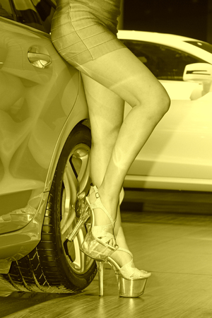 wheels and purple skirt high-heeled shoes in a auto show