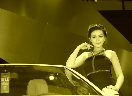 hebei: TANGSHAN - MAY 31: Beauty model in a car markets,on may 31, 2014, Tangshan city, Hebei Province, China
