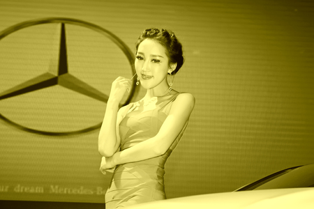 TANGSHAN - MAY 31: Beauty model in a car market on may 31, 2014, Tangshan city, Hebei Province, China