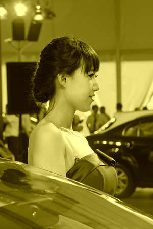 arms trade: TANGSHAN - MAY 31: Beauty model in a car markets,on may 31, 2014, Tangshan city, Hebei Province, China Editorial