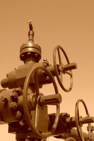 green petroleum machinery and red handwheel, closeup of photo Stock Photo