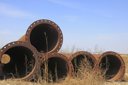 Dredging steel pipe piles in the open air Stock Photo