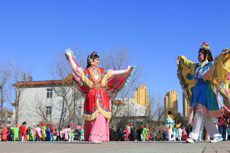 Luannan County- February 18: Chinese traditional style yangko folk dance performance in the street, on February 18, 2016, luannan County, hebei Province, China Stock Photo - 76618473