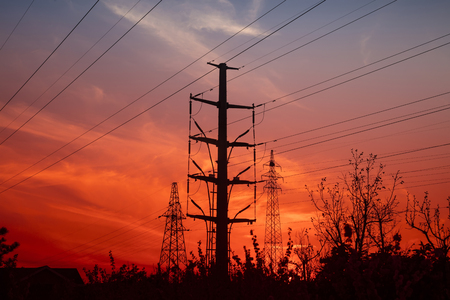 Electric power tower under the setting sun