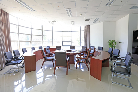 tables and chairs in a conference room, closeup of photo