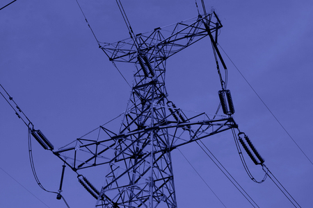power cables: electric tower in the blue sky, steel power transmission facilities Stock Photo