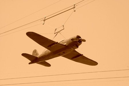 alloy: suspended model plane under sky, closeup of photo Stock Photo