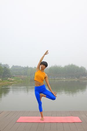 hebei: Luannan county - July 25: A woman doing yoga exercise in the park, on July 25, 2015, luannan county, hebei province, China