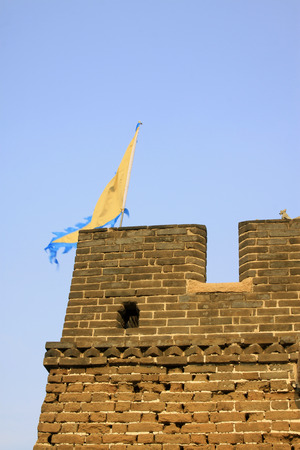 yellow flag on the wall, ancient Chinese architecture Stock Photo