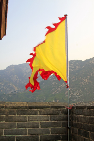 yellow flag on the wall, ancient Chinese architecture Editorial