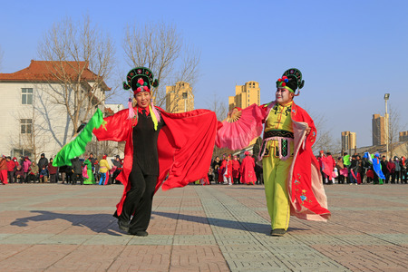 Luannan County- February 23: Chinese traditional style yangko folk dance performance in the street, on February 23, 2016, luannan County, hebei Province, China