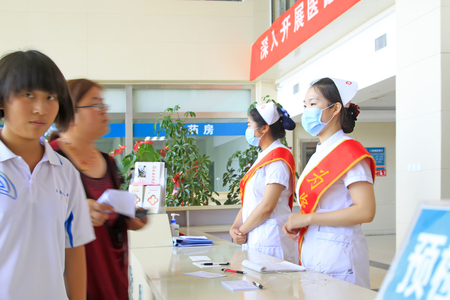 inquiry: Luannan County - June 18: Doctor guide medical service in the lobby, June 18, 2015, Luannan County, Hebei Province, China Editorial