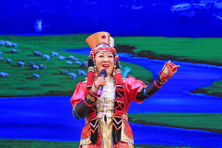 Luannan County - December 23, 2015: Mongolian songs, on the stage, Luannan County, Hebei Province, China, December 23, 2015. Mao Zedong was the former leader of Peoples Republic of China. Editorial