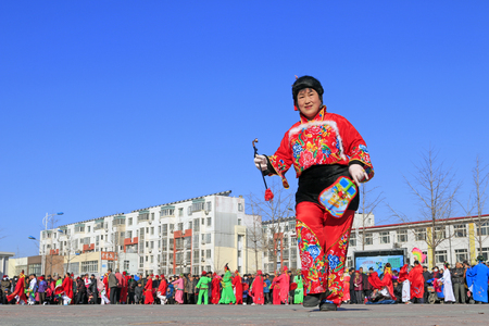 Luannan County- February 20: Chinese traditional style yangko folk dance performance in the street, on February 20, 2016, luannan County, hebei Province, China Editorial