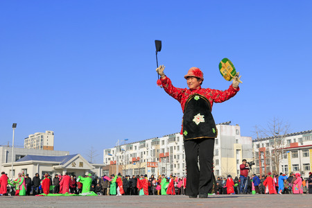 Luannan County- February 24: Chinese traditional style yangko folk dance performance in the street, on February 24, 2016, luannan County, hebei Province, China Editorial