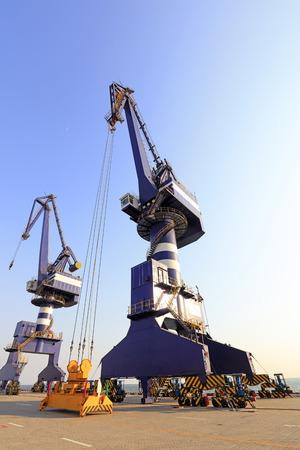 arms trade: Wharf crane low angle view Stock Photo