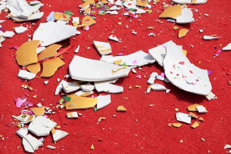 Broken ceramic pieces on the red carpet