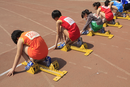100 meter runner ready to start Editorial