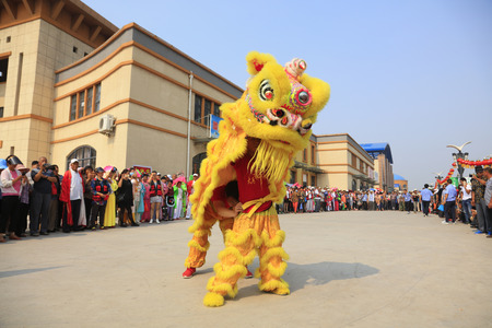 Luannan County - June 16, 2016: Chinese traditional lion dance performance at the temple fair, Luannan County, Hebei Province, China Editorial