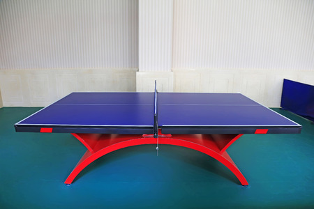 table tennis tables in a gymnasium