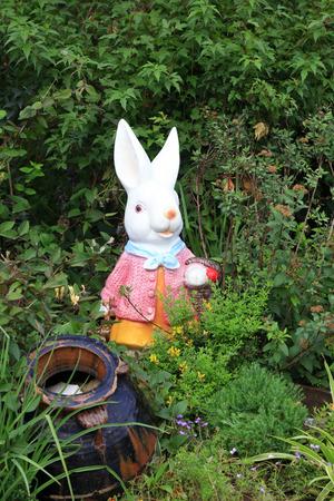 sculptures of rabbit models in the garden