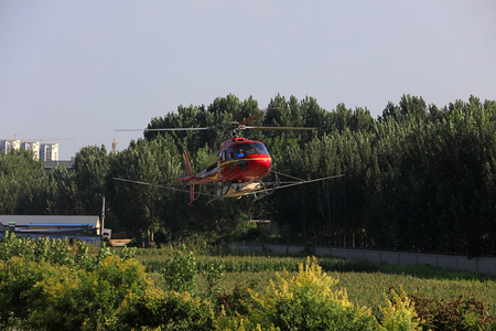 Luannan County - September 3, 2018: Agricultural helicopters flying in the air, Luannan County, Hebei Province, China