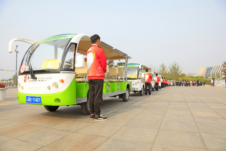 Tangshan City - April 29, 2016: battery cars and crew waiting for visitors in the park, South Lake Park, Tangshan City, Hebei, China Stock Photo - 113810129