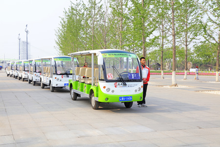Tangshan City - April 29, 2016: battery cars and crew waiting for visitors in the park, South Lake Park, Tangshan City, Hebei, China Stock Photo - 113810150