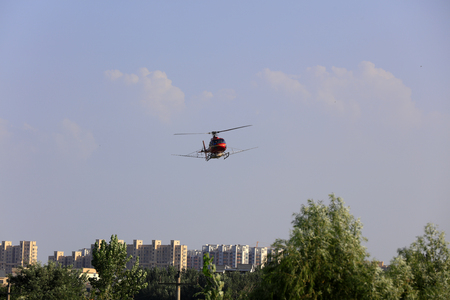 Agricultural helicopters flying over the city