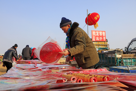 Luannan County - February 8, 2018: people choose to buy red lanterns at the market, Luannan, Hebei, China