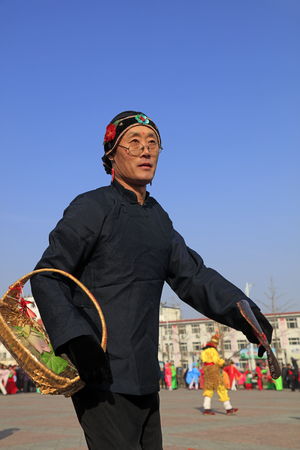 Luannan County - February 23, 2018: Yangge Dance Performance on the square, Luannan County, Hebei Province, China. Stock Photo - 118179910