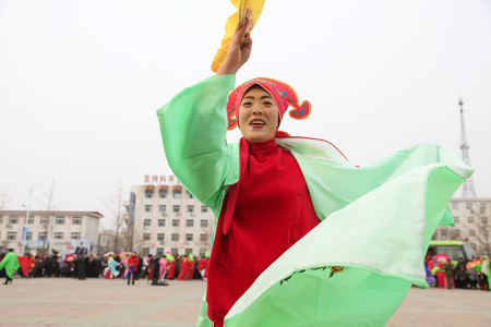 Luannan County - February 27, 2018: Yangge Dance Performance on the square, Luannan County, Hebei Province, China. 写真素材 - 119171135