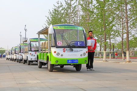 Tangshan City - April 29, 2016: battery cars and crew waiting for visitors in the park, South Lake Park, Tangshan City, Hebei, China