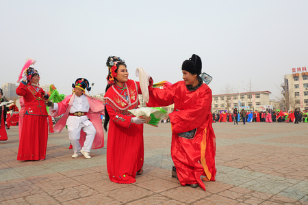 Luannan County - February 27, 2018: Yangge Dance Performance on the square, Luannan County, Hebei Province, China. Stock Photo - 119172092