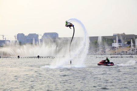 Tangshan City - October 2, 2016: Aquatic stunts in parks, Tangshan City, Hebei, China.