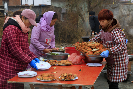 Luannan County - November 11, 2016: cook dishes, in Chinese style wedding ceremony, Luannan County, Hebei Province, China