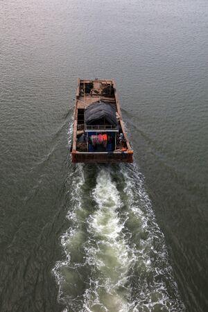 Fishing boats sailing in shallow waters, China