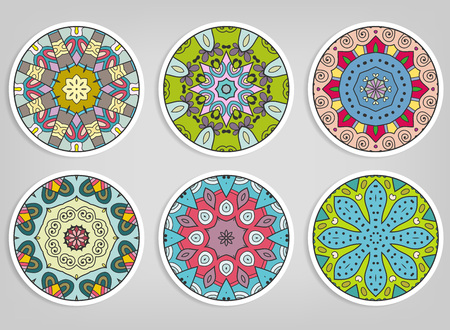 Decorative round ornaments set, isolated elements. Colorful mandala, stylized flower. Abstract geometric doodle patterns for plate decoration, fabric print, business or greeting card design Stock Illustratie