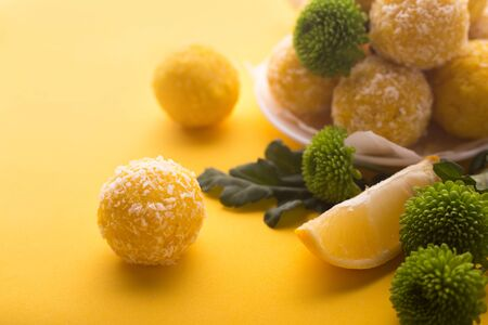 Healthy organic energy granola bites with lemon, nuts and honey - vegan vegetarian raw snack or meal