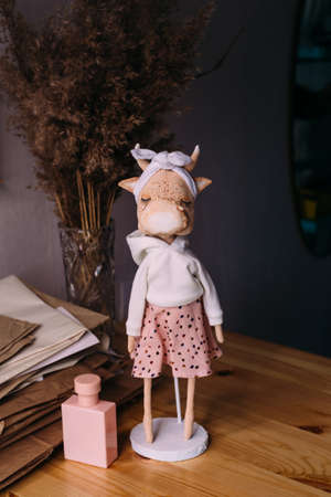 Authors original self-made doll bull and cow with a beautiful painted face