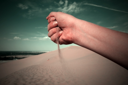 In the hands of sand photo