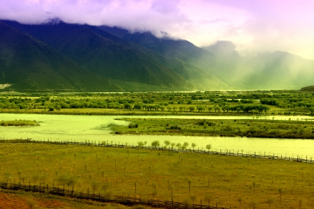 Rivers and mountains rural scenery of Tibet in China photo