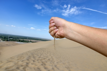 Loss of sand in hands photo