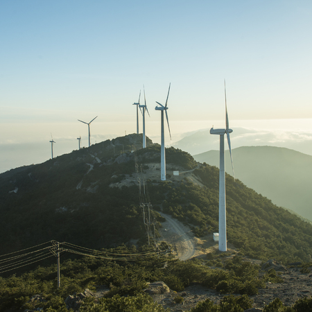 Wind farm mountain sunrise