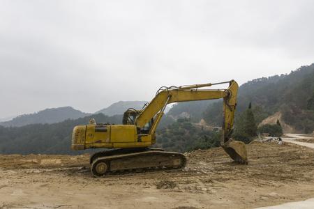 Excavator at mountain road