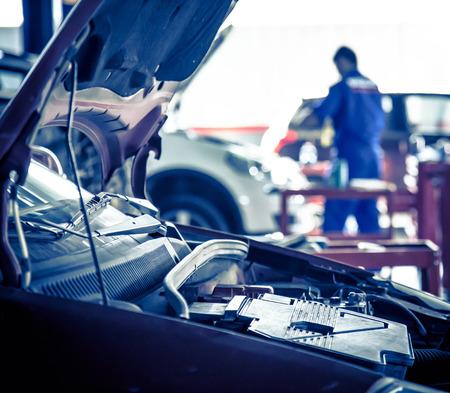 auto repair: Auto repair factory workers. Stock Photo